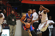 "SMU's London Giles (11) vs. Ole Miss' Jarvis Summers (32) at the C.M. ""Tad"" Smith Coliseum in Oxford, Miss. on Tuesday, January 3, 2012. Ole Miss won 50-48."