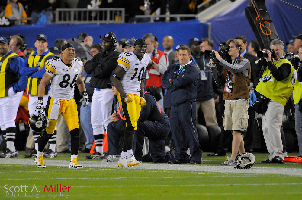 Feb 1, 2009; Tampa, FL, USA; Pittsburgh Steelers wide receiver Santonio Holmes (10) celebrates scoring the winning touchdown late in the fourth quarter of the Steelers 27-23 win over the Arizona Cardinals in Super Bowl XLIII at Raymond James Stadium. ©2009 Scott A. Miller.