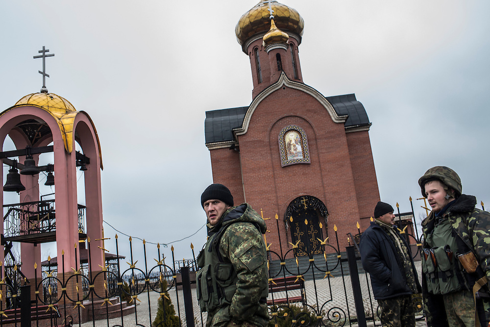 KARLIVKA, UKRAINE - NOVEMBER 19, 2014: Members of the Dnipro-1 brigade, a pro-Ukraine militia, stop near a church on their way to the front lines in Karlivka, Ukraine. CREDIT: Brendan Hoffman for The New York Times