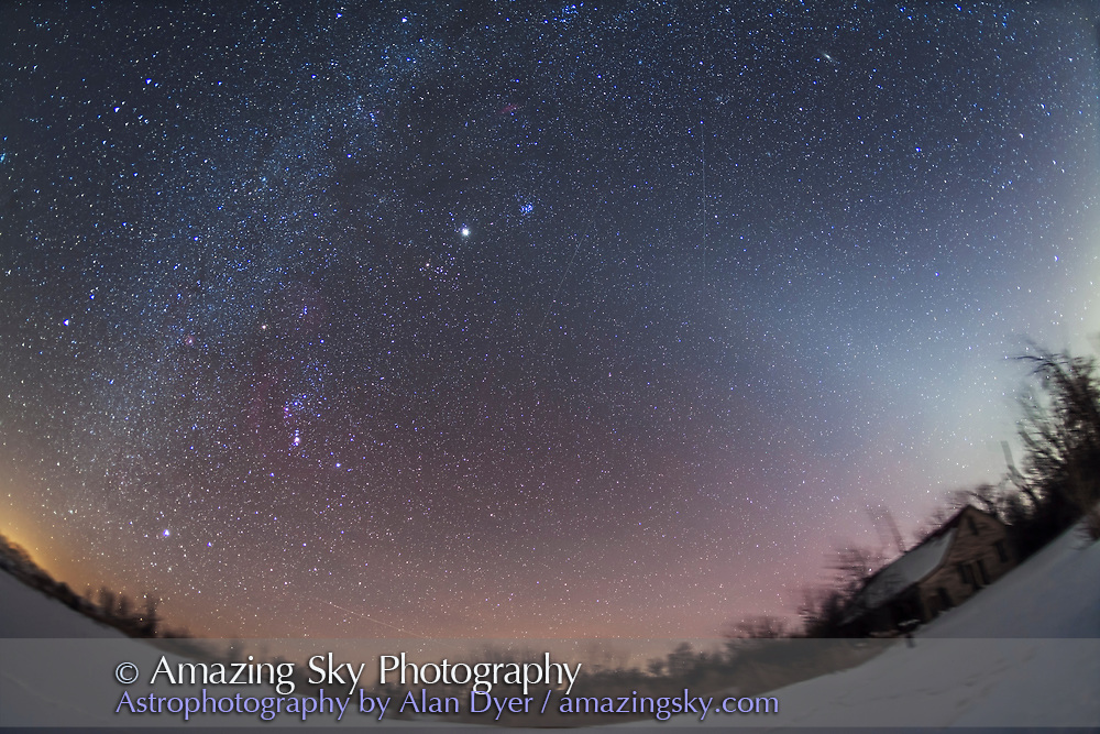 The Zodiacal Light in the evening western sky, from the northern hemisphere, on a snowy February evening under very clear skies. Taken from home in rural Alberta, with the Canon 15mm lens and Canon 5D MkII camera at ISO 800 for a stack of 4 x 4 minute exposures at f/3.5, though the ground is from just one exposure. Taken from southern Alberta, Canada.