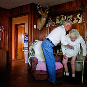 "Bernard Triplet helps Mary get up from the commode. She frequently thinks she has to use the facilities while other times she looses control of her bladder without realizing it. ""I've got a tough job, but I love her and I'll take care of her, for better or worse,"" Bernard said."