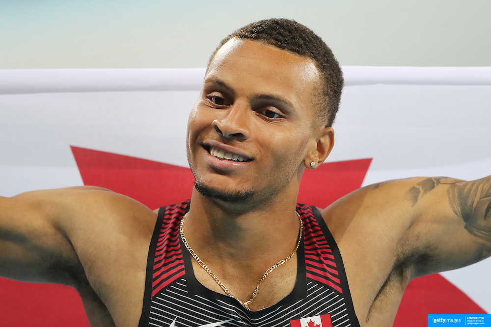 Athletics - Olympics: Day 9   Andre De Grasse of Canada celebrates after winning the bronze medal in the Men's 100m Final at the Olympic Stadium on August 14, 2016 in Rio de Janeiro, Brazil. (Photo by Tim Clayton/Corbis via Getty Images)