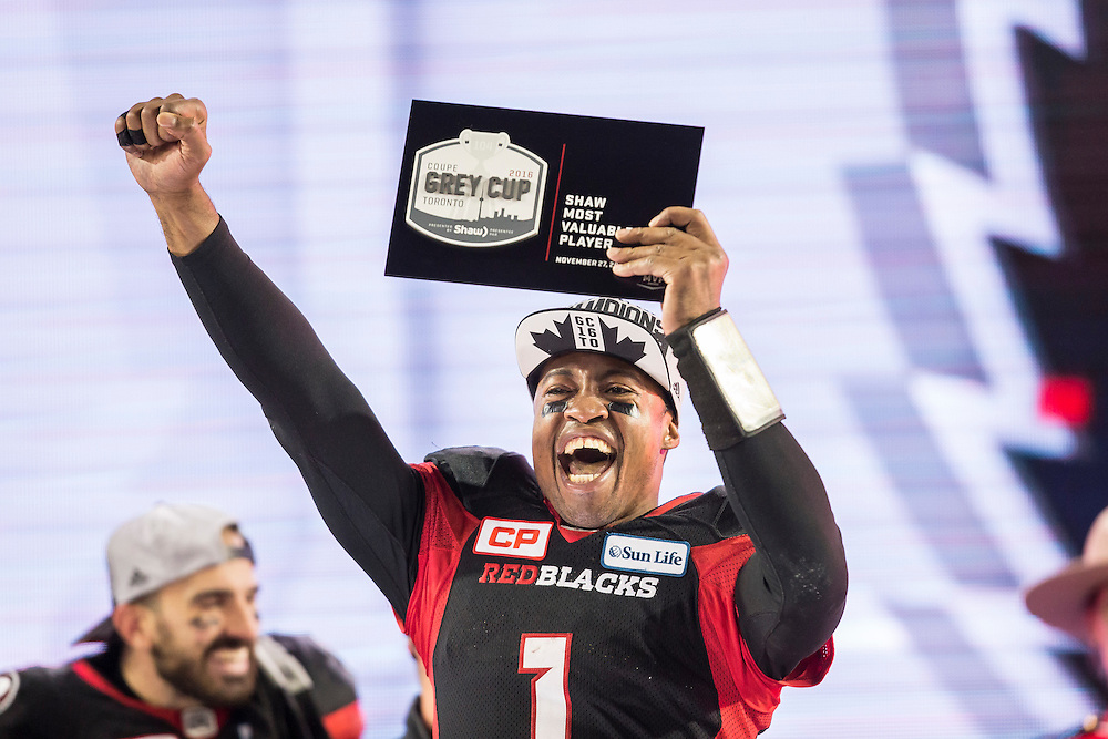 Ottawa quarterback Henry Burris celebrates his Most Valuable Player award at the 104th Grey Cup Final game against the Calgary Stampeders in Toronto Ontario, Monday,  November 28, 2016.  (CFL PHOTO - Geoff Robins)