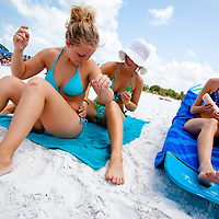 SARASOTA, FL -- June 14, 2011 --  Carrie Swope, 18, left to right, Kali Gough, 17, and Allie Harris, 18, all of Sarasota, as they prepare to lay out at Siesta Public Beach in Sarasota, Fla., on Tuesday, June 14, 2011.