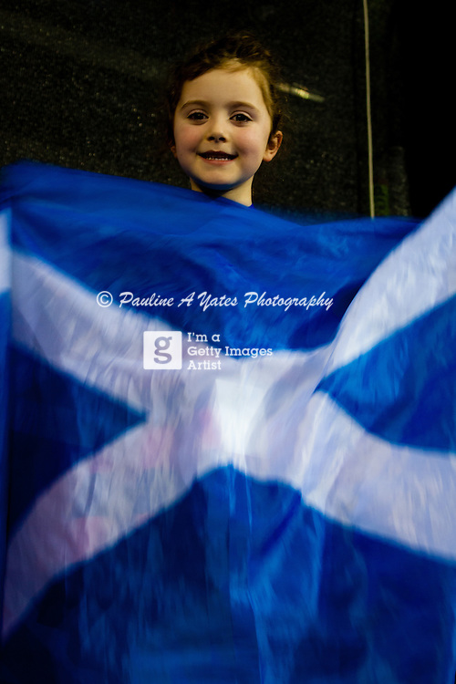 A little Scottish girl cheers Andy Murray's win with her Cross of St Andrew flag at the Davis Cup in Glasgow