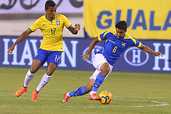 Sep 9, 2014; East Rutherford, NJ, USA; Ecuador midfielder Christian Noboa (6) plays the ball away from Brazil midfielder Luiz Gustavo (17) during the first half at MetLife Stadium.
