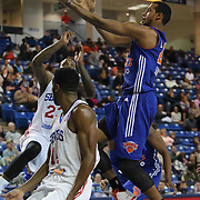 Westchester Knicks Forward Orlando Sanchez (21) as Delaware 87ers Forward Victor Rudd (23) and Delaware 87ers Forward Malcolm Lee (14) defends in the first half of a NBA D-league regular season basketball game between the Delaware 87ers and the Westchester Knicks (New York Knicks) Sunday, Dec. 28, 2014 at The Bob Carpenter Sports Convocation Center in Newark, DEL