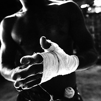 USE ARROWS &larr; &rarr; on your keyboard to navigate this slide-show<br /> <br /> Yangon, Myanmar May 2006<br /> Boxing fighters of the KLN boxing school. Most of them are part of the Karen minority ethnic group.<br /> On this picture: Boxer Saw Zaw Lwin , 34 years old.<br /> Photo: Ezequiel Scagnetti
