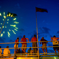 Watching fireworks after the end of a Madison Mallards baseball game in Madison, Wisconsin. ..