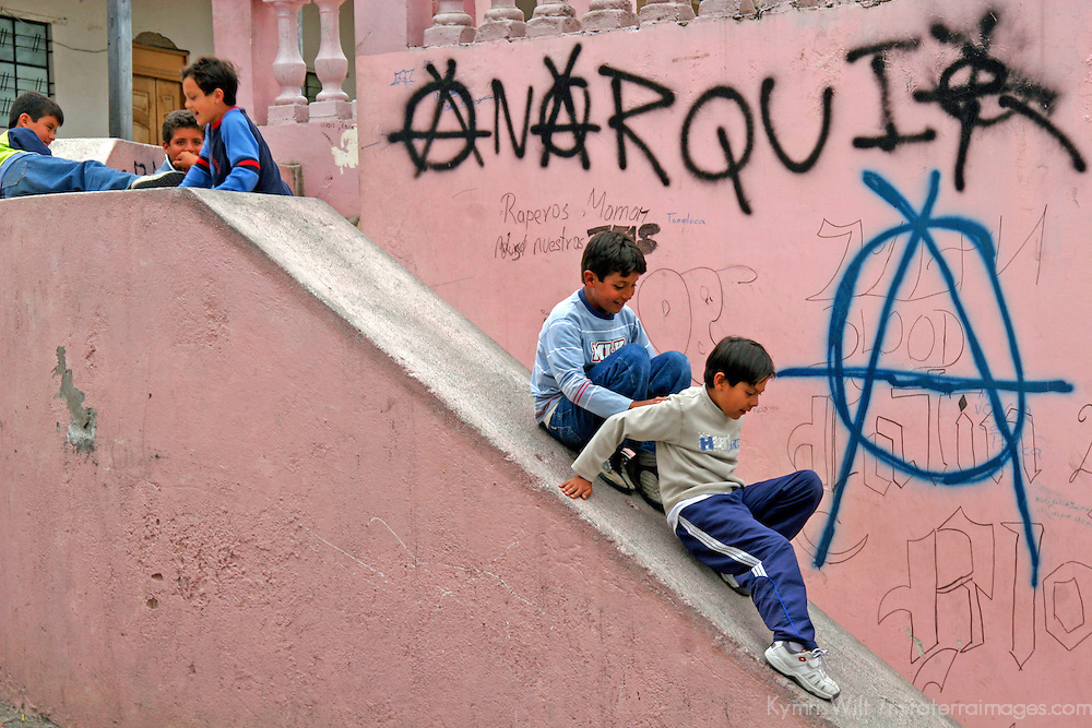 Americas, South America, Ecuador, San Antonia de Ibarra. Local kids find fun in anarchy of a makeshift slide in an Andean town in Ecuador.
