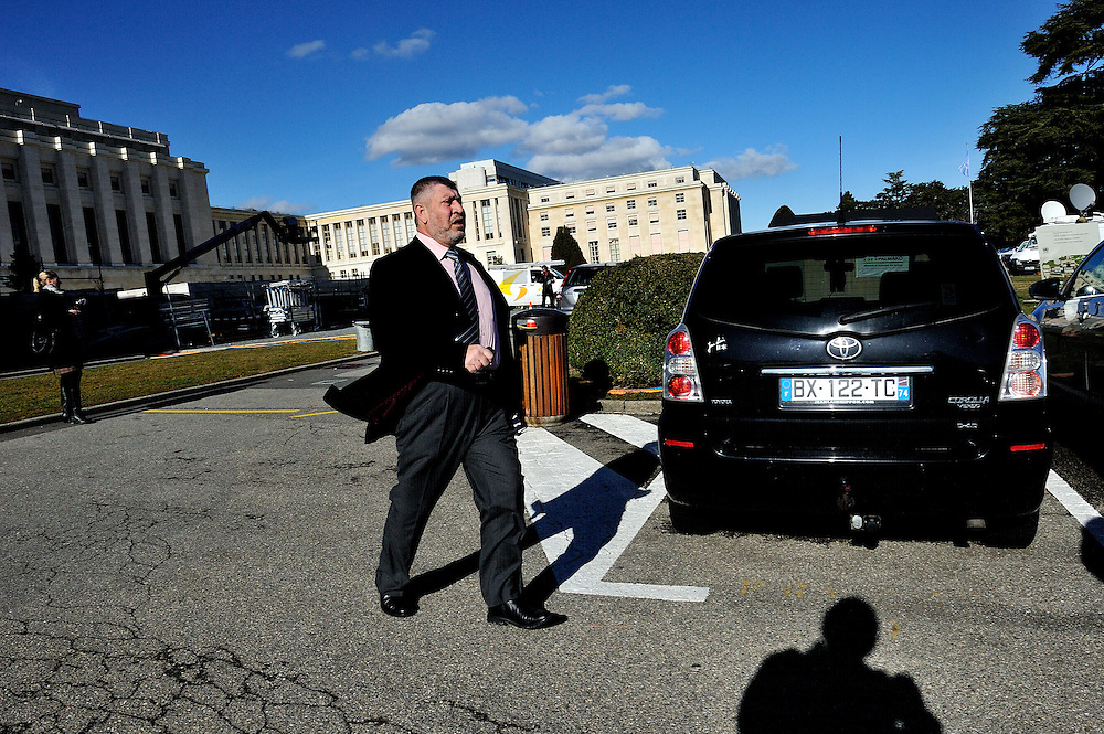 BBC Arabic Service correspondent running after the Syrian givernment delegation on the second day of the second round of the Geneva 2 Syria peace talks, at the UN Palais des Nations.