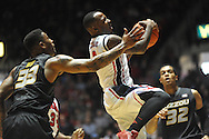 "Mississippi's Derrick Millinghaus (3) scores against Missouri's Earnest Ross (33) at the C.M. ""Tad"" Smith Coliseum in Oxford, Miss. on Saturday, February 8, 2014. Mississippi won 91-88."