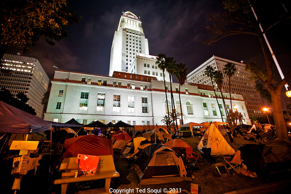 Day 18 at Occupy L.A. around L.A. city Hall. A group of tents at night on L.A. city hall's lawn.