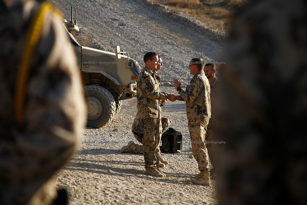 German Oberstleutnant M. (Lieutenant Colonel) speaks in front of his Battalion to gives an information update to his soldiers and to grant two of them with medals of honor at OP North, Northern Afghanistan