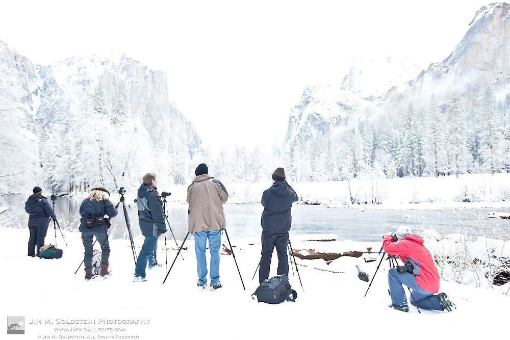 A group of photographers photograph a snow covered Yosemite Valley - Yosemite National Park, California