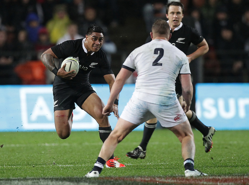 New Zealand's Malakai Fekitoa is challenged by England's Dylan Hartley  in an International Rugby Test match, Waikato Stadium, Hamilton, New Zealand, Saturday, June 21, 2014.  Credit:SNPA / David Rowland