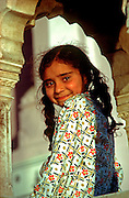 INDIA, RELIGION, SIKHISM Portrait of Sikh child in Amritsar at the Golden Temple