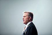 SHOT 3/20/12 1:58:03 PM - John Elway, the executive vice president of football operations for the Denver Broncos, answers questions about free agent quarterback Peyton Manning at team headquarters in Englewood, Co. at a press conference on Tuesday Marc 20, 2012. Manning is coming off neck surgery and was released by the Indianapolis Colts. He signed a five year, $96 million contract with the Broncos..(Photo by Marc Piscotty / © 2012)