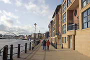 Family walking past new riverside housing by the River Tyne in Newcastle upon Tyne ..., Travel, lifestyle