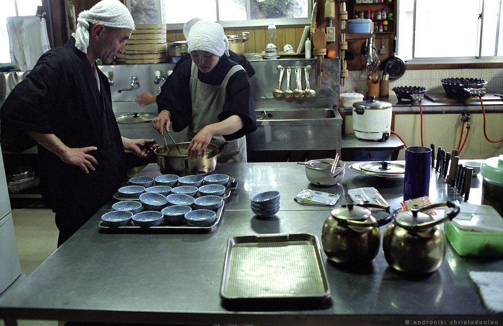 LIVING ZEN - HOSHINJI MONASTERY, OBAMA-JAPAN..Monk and nun in the kitchen, preparing lunch..The monastery is mixed and men and women take equal part in the practice..
