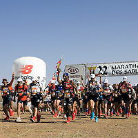 25 March 2007:  757 participants rush for the start of the 22nd Marathon des Sables, a 6 days and 151 miles endurance race with food self sufficiency across the Sahara Desert in Morocco. Each participant must carry his, or her, own backpack containing food, sleeping gear and other material.