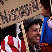 Wisconsinites rally to protest Wisconsin Governor Scott Walker's budget repair bill at the Capitol Wednesday, February 16 in Madison, Wis. Kris Ugarriza - Red Wave Pictures