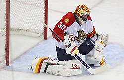April 24, 2012; Newark, NJ, USA; New Jersey Devils center Travis Zajac (19) scores the game winning goal past Florida Panthers goalie Scott Clemmensen (30) during overtime of game six of the 2012 Eastern Conference quarterfinals at the Prudential Center.  The Devils defeated the Panthers 3-2.