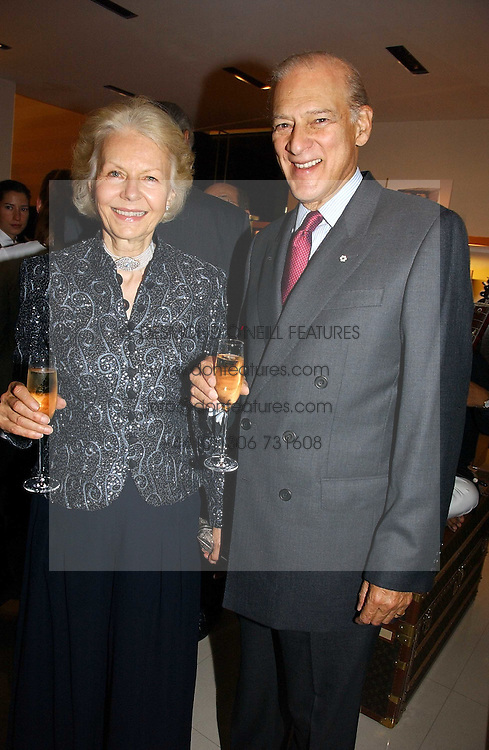 SIR CHRISTOPHER &amp; LADY ONDAATJE at a party to celebrate the publication of 'Made for Maharajas' by Dr Amin Jaffer hosted by Louis Vuitton at their store on Sloane Street, London on 10th October 2006.<br />
