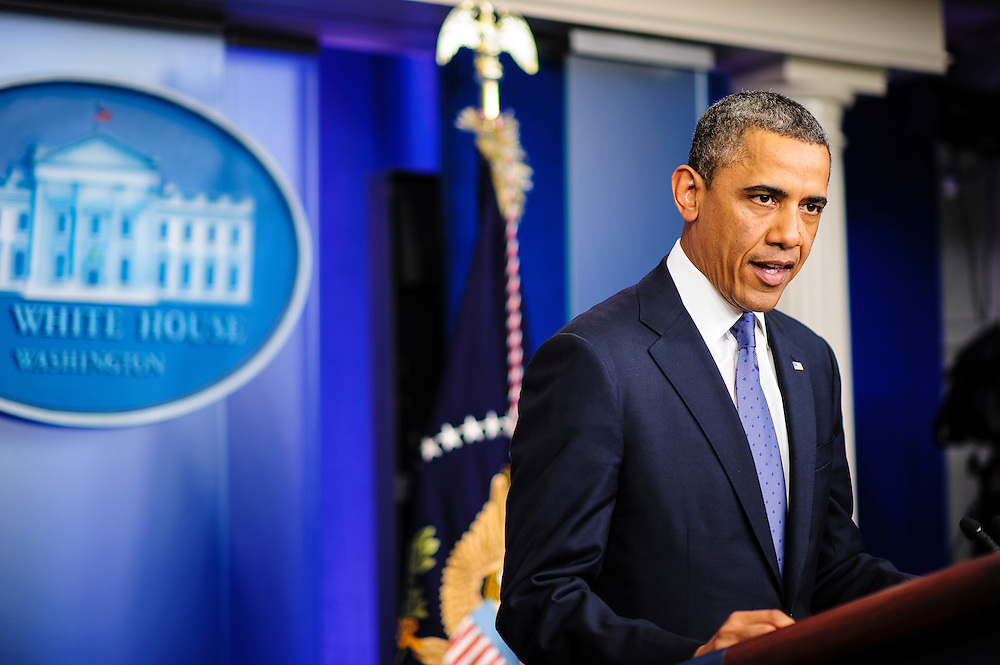 """President Barack Obama said he was optimistic about Fiscal Cliff negotiations during a press conference at the White House in Washington, District of Columbia, U.S., on Friday, Dec. 28, 2012. The remarks to the press followed a  meeting with Senate and House Republican leaders at the White House to discuss the looming tax hikes and spending cuts of the approaching """"fiscal cliff."""".Photographer: Pete Marovich/Bloomberg"""
