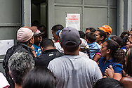 2016/05/26 - Caracas, Venezuela: People try to enter inside MiniCentral Madeirense Super Market in La Urbina neighbourhood in Caracas, after it was annouced that there was no more subsidized butter available. People sometimes spend the all day and night waiting in line just to be able to buy a few products. (Eduardo Leal)