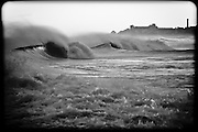 Waves resembling chocolate chips peel across the surface at Rockaway Beach, Queens, NY.