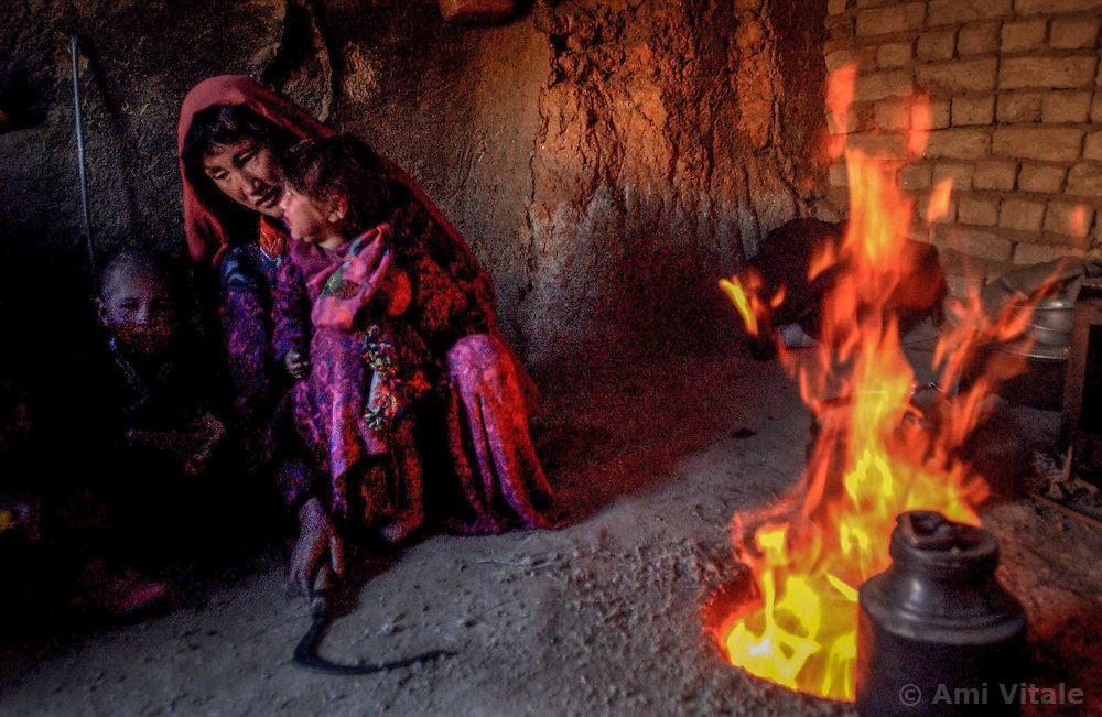 ANBAR SOMUCH, AFGHANISTAN,  JULY 31, 2002: The village of Anbar Somuch,  Afghanistan, July 31, 2002. More than 100 families have returned to their village after the fall of the Taliban and they are rushing to rebuild their homes before the brutal winter sets in. (Photo by Ami Vitale)