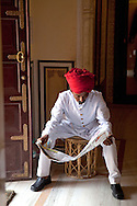 Guard reading newspaper, Amer Fort, Jaipur, India