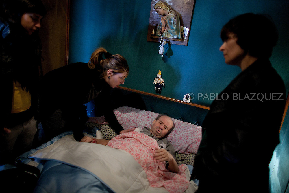 Vicente's niece, Pilar Moreno takes care of Vicente while he feels legs pain before Court officials and Citibank representative arrive to evict him , on April 18 2012, in Madrid, Spain. Spanish Vicente Torres, 73, who is severely ill and underwent a recent heart surgery, and is waiting for a thrombus surgery faces an eviction from his house after he endorsed his son, so Citibank would concede a credit to buy a house. His son already handed his house to the bank. Torres has lived at his home for the last 55 years and was paying it for 30 years. Eviction procedures in Spanish courts for unpaid mortgages and rent hit a record of 58,241 in 2011, a 21.2 percent rise over the previous year. Evictions have soared in Spain since the collapse of a property bubble in 2008 that triggered the country's economic crisis.