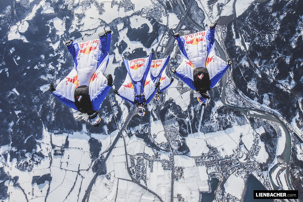 The Red Bull Skydive Team flies their wingsuits over the snowcovered outskirts of Salzburg