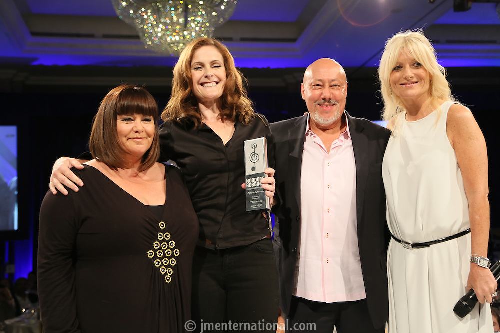 (L-R) Dawn French, Alison Moyet, Dr Allan Zimeler - Investec and Gabby Roslin. The Silver Clef Lunch 2013 in aid of  Nordoff Robbins held at the London Hilton, Park Lane, London.<br /> Friday, June 28, 2013 (Photo/John Marshall JME)