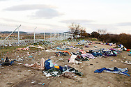 02 December 2015, Greece, Idomeni - Migrants and refugees wait to cross the Greek-Macedonian border near the village of Idomeni, Greece. Remains of the migrants refugees passage near the border.