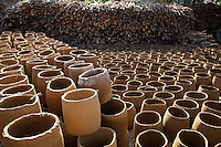 Burnay Pottery out for its Final Drying Session - Burnay is a type of earthenware crafted with fine sand for tempering and is fired at  high temperature in huge ground kilns which makes it more durable than other types of terracotta.  Local fish sauce, and sugarcane vinegar would not taste as good if not fermented in stoneware burnay jars. Burnay technique was brought to Vigan by Chinese artisans.