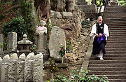 LIVING ZEN - HOSHINJI MONASTERY, OBAMA-JAPAN..Monk returning from a ceremony for the dead at the graveyard of the monastery..One of the main services the monastery offers to the local community is performing ceremonies for the dead..