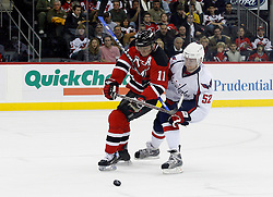 December 7, 2007; Newark, NJ, USA;  Washington Capitals defenseman Mike Green (52) hooks New Jersey Devils center John Madden (11) during the second period at the Prudential Center in Newark, NJ.