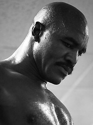 November 9, 2004; New York, NY; USA; Former heavyweight Champion Evander Holyfield takes a moment during a workout at the Kingsway Gym in New York City.