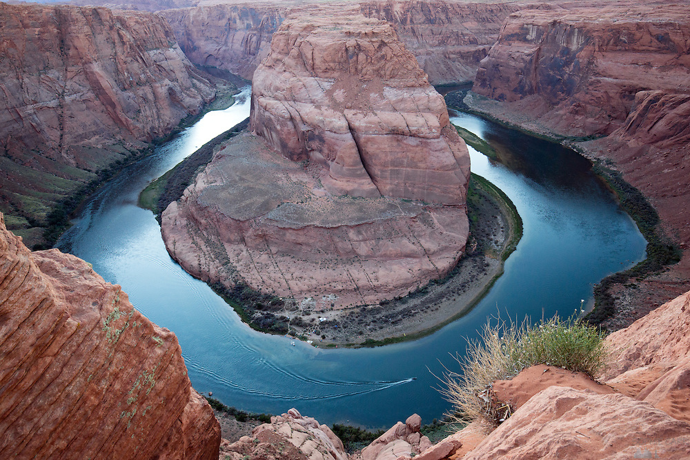 A boat on the Colorado River at Horseshoe Bend, near Page, Arizona, just after sunset