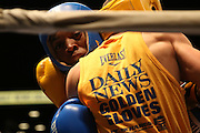April 1, 2015 - New York, NY. <br /> Teon Thorne (blue) pushes towards the ropes during the 108 lb bout with Nicholas Scaturchio (gold). 04/01/2015 Photograph by Maya Dangerfield/NYCity Photo Wire