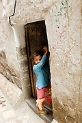 Child at doorway of her home in San'a'