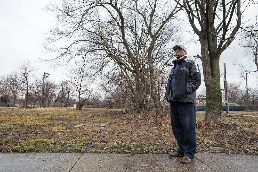 "Steven Rogers stands in front of a vacant lot he owns on Normal Boulevard, between 56th Place and 57th Street in late-January on land slated for rail yard expansion by Norfolk Southern. On January 15th, the railroad company sent him a letter of intent to enforce eminent domain. But Rogers refuses to give up his land and still has hopes to develop new residences for the Englewood community. ""It should have never gotten to this,"" he says of the land battle with Norfolk Southern."