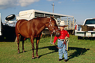 Young cowboy with winners trophy at horse show in Oklahoma, <br /> MODEL RELEASED