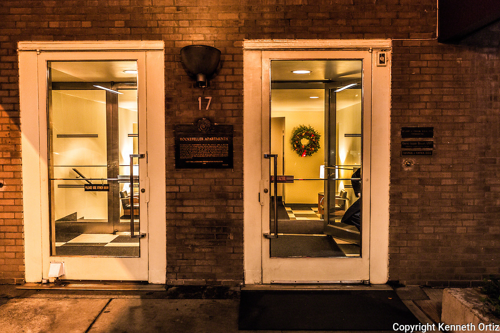 A shot of a doorman sitting at his post at the Rockefeller Apartments at 17 West 54th Street in Midtown Manhattan.