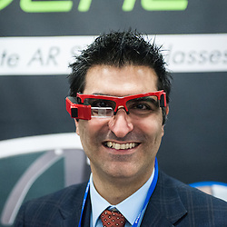 London, UK - 17 March 2014:  Kayvan Mirza, CEO, wears smart glasses ORA by Optinvent at the Wearable Technology Conference at Olympia in London