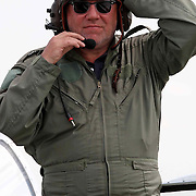 "ACTOR RAY WINSTONE AFTER FLYING IN A P-51 MUSTANG AT THE IMPERIAL WAR MUSEUM DUXFORD,CAMBS,ON TUESDAY AFTERNOON... Actor Ray Winstone got in some play time today (Tues) as he flew in aeroplane ahead of filming upcoming movie The Sweeney this autumn...Ray, who will play Flying Squad detective Jack Regan in the film, took to the skies in a P-51 Mustang at The Imperial War Museum in Duxford, Cambs...""Ray is a very keen aviation fan and has often spoken of his desire to learn to fly a plane,"" said a spokesman for the museum...Afterwards  Ray said he  was thrilled with the flight and claimed he did not throw up,''Men from the East End are never sick"" he said...Based on the original ITV cult show, The Sweeney will be a modernization of the London Flying Squad, directed by Nick Love...It will be set in present day England and be packed full of fast cars and action...Ray will star alongside Ben Drew (Plan B) who will play his partner George Carter...SEE COPY CATCHLINE Ray Winstone plane"