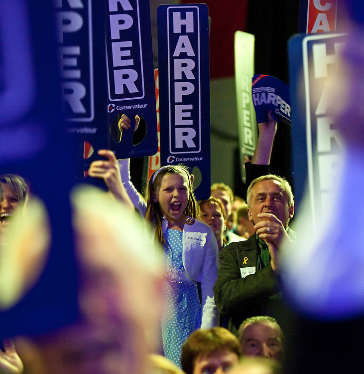 Conservative supporters react to the projection of a Conservative majority government as they await the arrival of Conservative leader Stephen Harper at the Telus Convention Centre in Calgary, Alberta, May 2, 2011.<br /> AFP/GEOFF ROBINS/STR